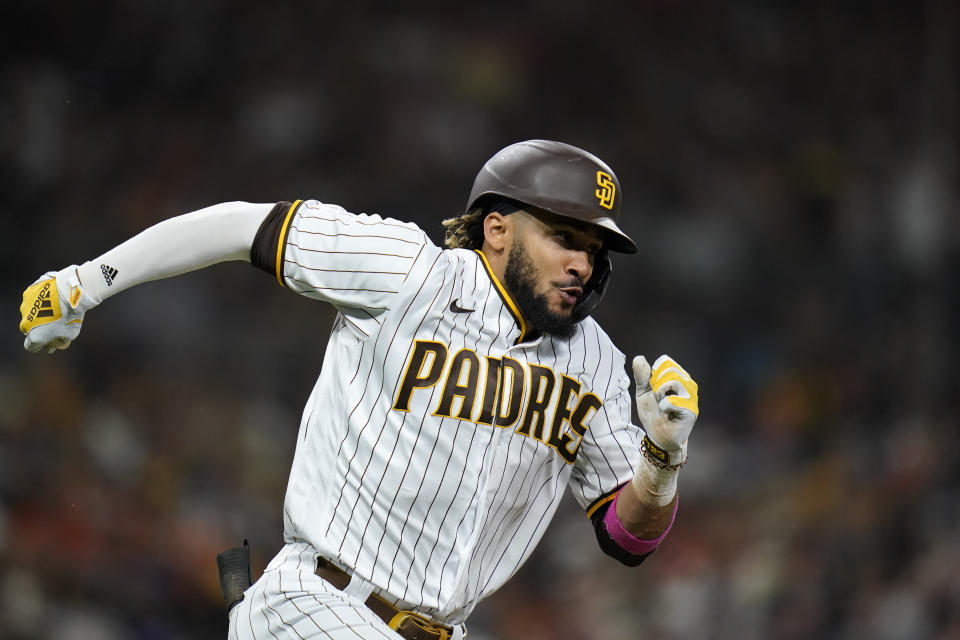 San Diego Padres' Fernando Tatis Jr. runs to first after hitting a single during the sixth inning of a baseball game against the San Francisco Giants, Tuesday, Sept. 21, 2021, in San Diego. (AP Photo/Gregory Bull)
