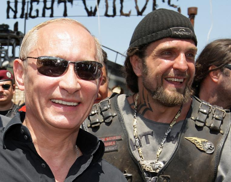 Vladimir Putin (L), then Russia's Prime Minister, walks with Alexander Zaldostanov (R), the leader of the group of Russian bikers called the Night Wolves, near Sevastopol, on July 24, 2010 in what was then Ukraine (AFP Photo/Alexey Druzhinin)