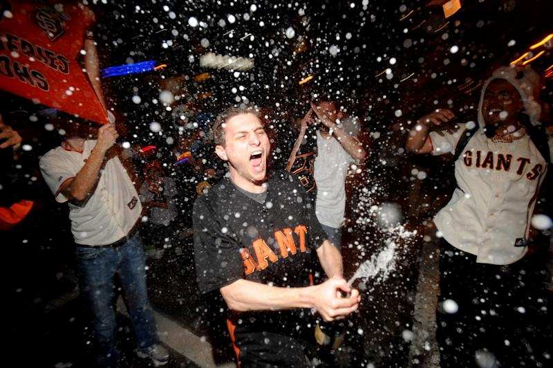 San Francisco Giants fan David Zweig celebrates outside PacBell Park on Sunday, Oct. 28, 2012, in San Francisco after the Giants swept baseball's World Series against the Detroit Tigers. (AP Photo/Noah Berger)