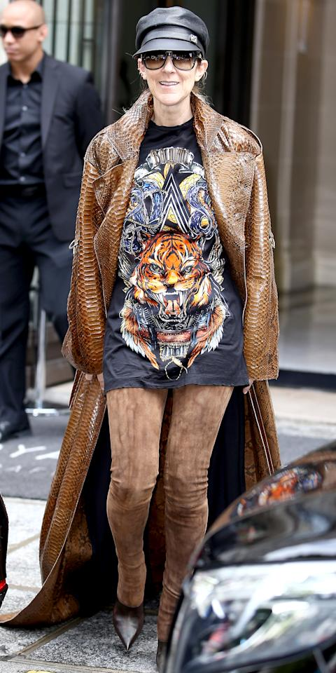<p>Who needs pants? Not Dion, who exited her hotel in Paris dressed in a Balmain boots that don't reveal an inch of skin but prove you can definitely say goodbye to traditional bottoms. She styled them with a matching graphic tee, a dramatic coat, and a black leather hat. </p>