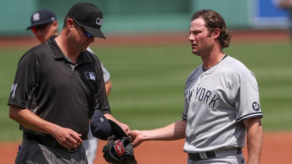 Gerrit Cole being checked for sticky stuff vs. Red Sox