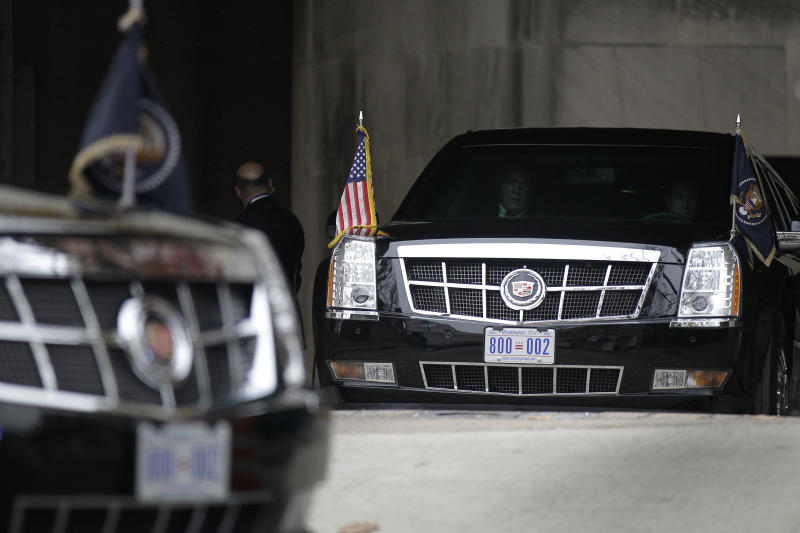 """FILE - In this Dec. 16, 2010 file photo, the presidential limousines are seen driving out of the Interior Department in Washington following an event. President Barack Obama's limousine will soon carry the District of Columbia's """"Taxation Without Representation"""" license plate, a subtle protest of the lack of voting rights in Congress for the city's 632,000 residents.   (AP Photo/Pablo Martinez Monsivais)"""