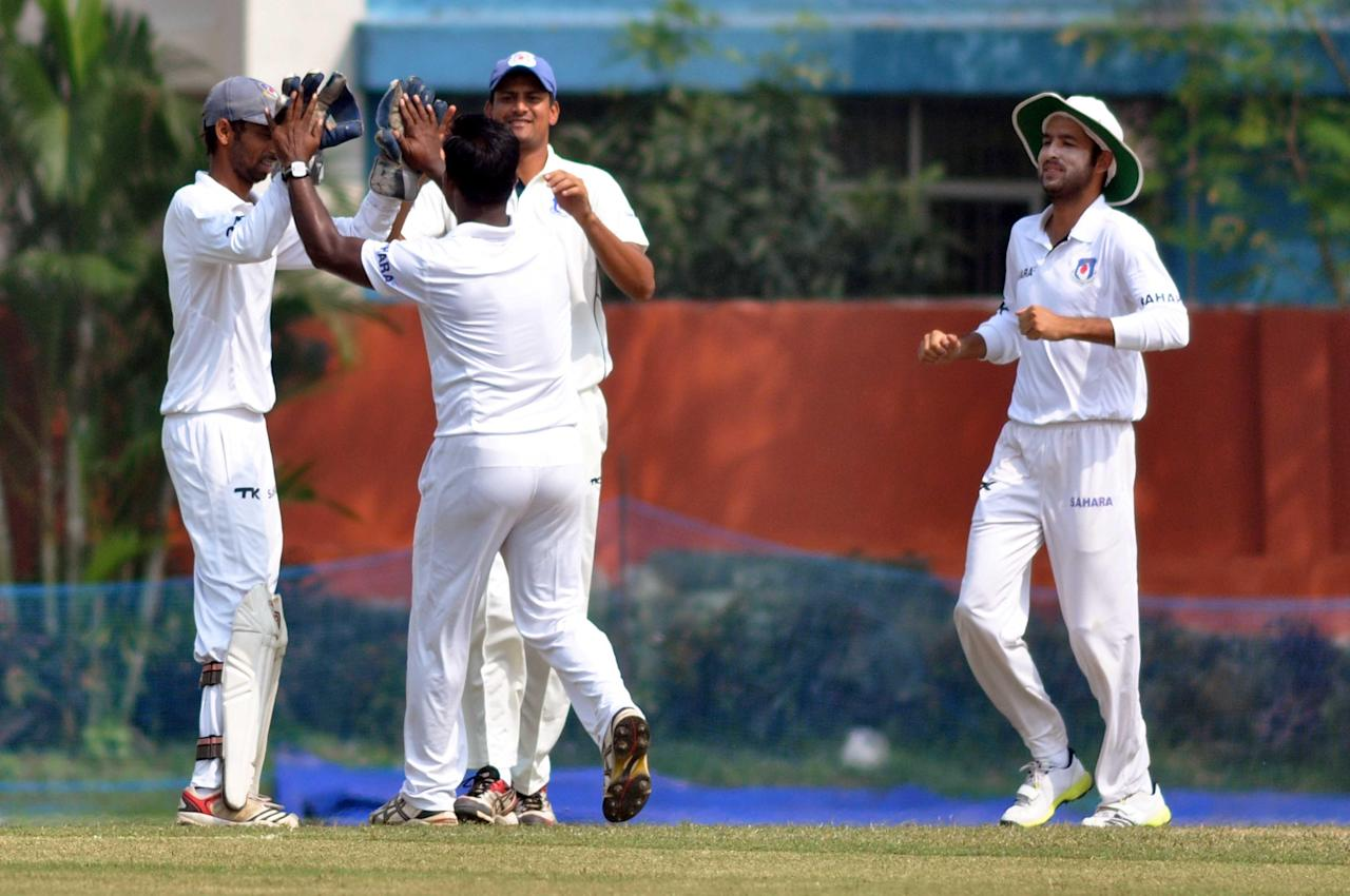 UPCA XI players celebrate fall of a wicket during Day 2 of practice match between West Indies and Uttar Pradesh Cricket Association XI at the Jadavpur University Ground in Kolkata on Nov.1, 2013. (Photo: IANS)