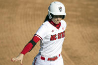 FILE - North Carolina State's Tatyana Forbes (16) runs to first base during an NCAA softball game against Boston College in Raleigh, N.C., in this Wednesday, Feb. 17, 2021, file photo. Division I softball is providing a training ground this season for players preparing for the 2021 Olympics. Oklahoma's Nicole Mendes and North Carolina State's Tatyana Forbes will play for Mexico, their schools said. (AP Photo/Ben McKeown, File)