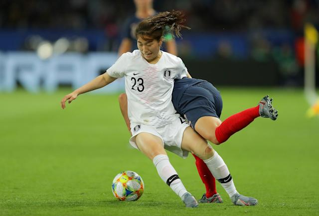 Chaerim Kang of Korea Republic is challenged by Amel Majri of France during the 2019 FIFA Women's World Cup France group A match between France and Korea Republic at Parc des Princes on June 07, 2019 in Paris, France. (Photo by Richard Heathcote/Getty Images)