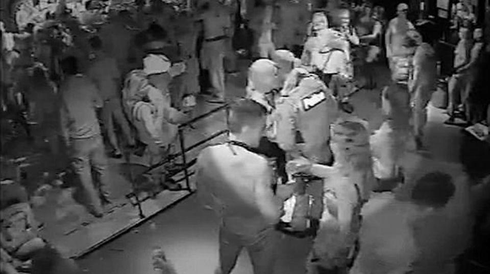 CCTV shows one woman can be seen wrapping her arms around an armed officer on the Inflation dance floor before the shooting. Picture: Supplied