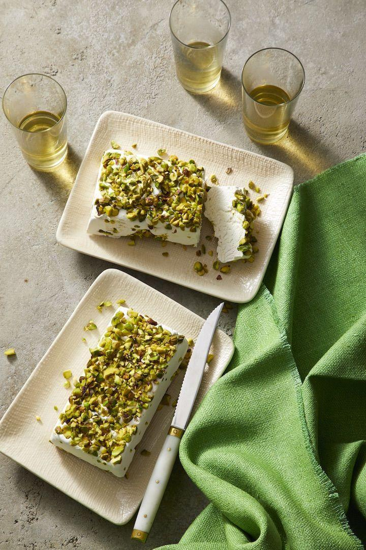 """<p>Skip making individual candies, and serve up a loaf of super sweet nougat coated with vibrant chopped pistachios.</p><p><em><a href=""""https://www.womansday.com/food-recipes/food-drinks/a26661934/divinity-candy-recipe/"""" rel=""""nofollow noopener"""" target=""""_blank"""" data-ylk=""""slk:Get the recipe from Woman's Day »"""" class=""""link rapid-noclick-resp"""">Get the recipe from Woman's Day »</a></em></p>"""