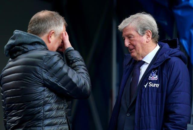 Chris Wilder, left, is consoled by Roy Hodgson after his side's 15th Premier League defeat of the season at Crystal Palace last Saturday