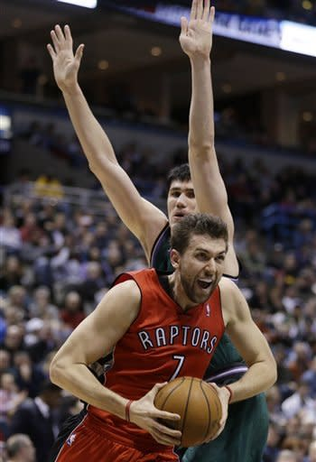 Toronto Raptors' Andrea Bargnani (7) drives against Milwaukee Bucks' Ersan Ilyasova during the first half of an NBA basketball game Saturday, March 2, 2013, in Milwaukee. (AP Photo/Jeffrey Phelps)