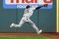 Pittsburgh Pirates' Gregory Polanco makes a running catch to get out Cleveland Indians' Delino DeShields during the second inning of a baseball game, Friday, Sept. 25, 2020, in Cleveland. (AP Photo/Ron Schwane)