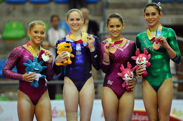 GUADALAJARA, MEXICO - OCTOBER 27: (L-R) Silver medal winner Shawn Johnson of the United States, gold medal winner Bridgette Carquatto of the United States and bronze medal winners Marisela Cantu and Elsa Garcia of Mexico pose after the Women's Artistic Gymnastics Finals in Uneven Bars during Day 13 of the XVI Pan American Games at the Revolution Sports Complex on October 27, 2011 in Guadalajara, Mexico. (Photo by Dennis Grombkowski/Getty Images)