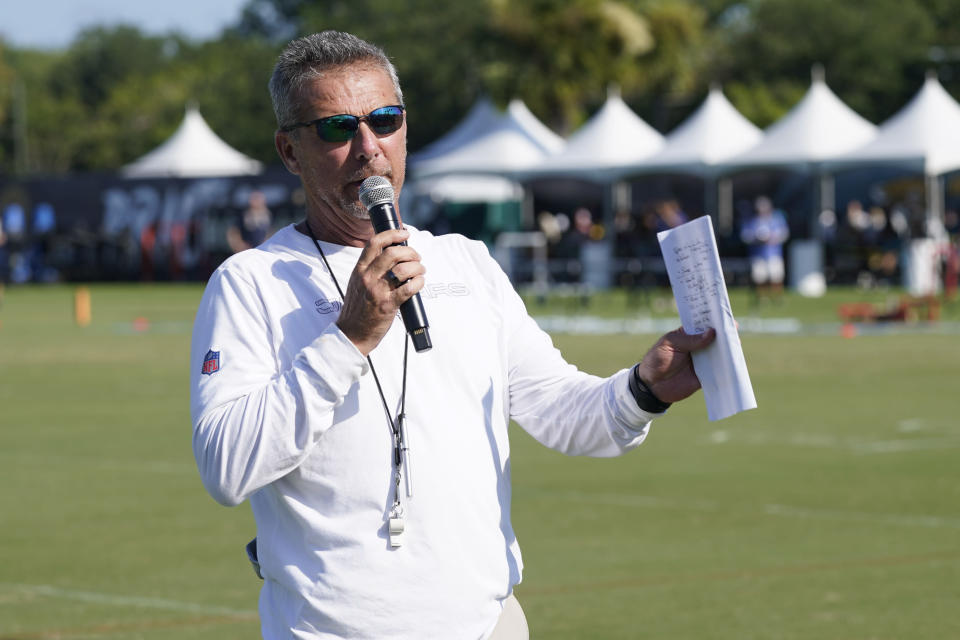 Jacksonville Jaguars head coach Urban Meyer makes remarks to fans before an NFL football practice, Saturday, July 31, 2021, in Jacksonville, Fla. (AP Photo/John Raoux)