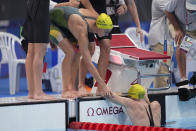 Australian women's 4x100m freestyle relay team's Emma McKeon congratulates teammate Cate Campbell, right, after winning the gold medal at the 2020 Summer Olympics, Sunday, July 25, 2021, in Tokyo, Japan. (AP Photo/Matthias Schrader)