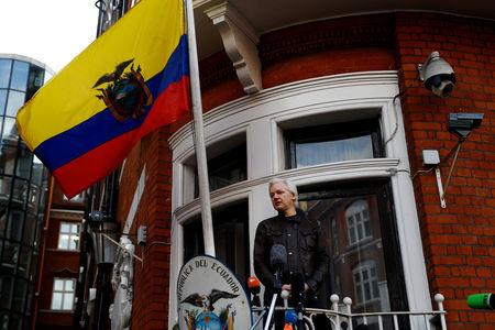 Assange turns on asylum host as he sues Ecuador