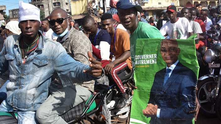 Supporters of Cellou Dalein Diallo on motorbikes in Guinea