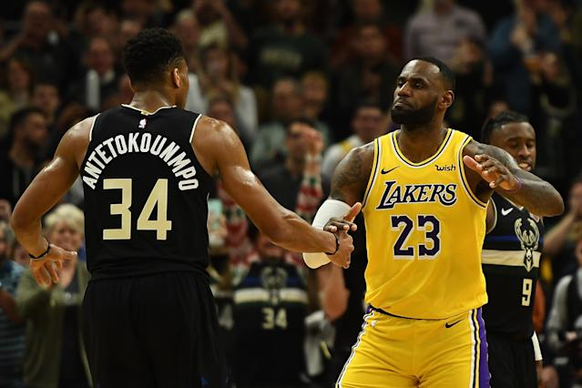 Giannis Antetokounmpo and LeBron James pay their respects during their meeting earlier in the season. (Stacy Revere/Getty Images)