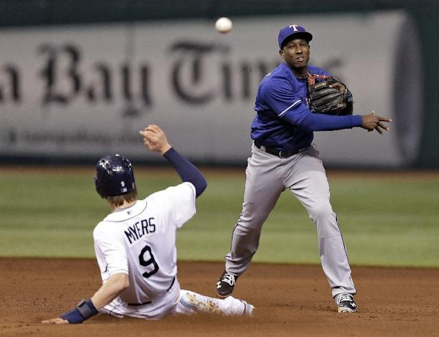 Texas Rangers second baseman Jurickson Profar, right, forces Tampa Bay Rays' Wil Myers at second base but his relay throw pulled first baseman Mitch Moreland off the bag and Rays Delmon Young was safe at first during an MLB American League baseball game Wednesday, Sept. 18, 2013, in St. Petersburg, Fla. (AP Photo/Chris O'Meara)