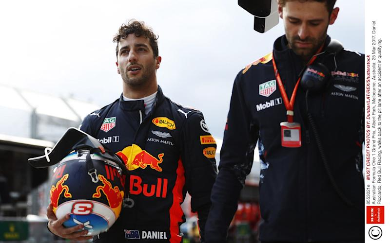 Daniel Ricciardo walks back to the pit lane - Credit: Rex Features