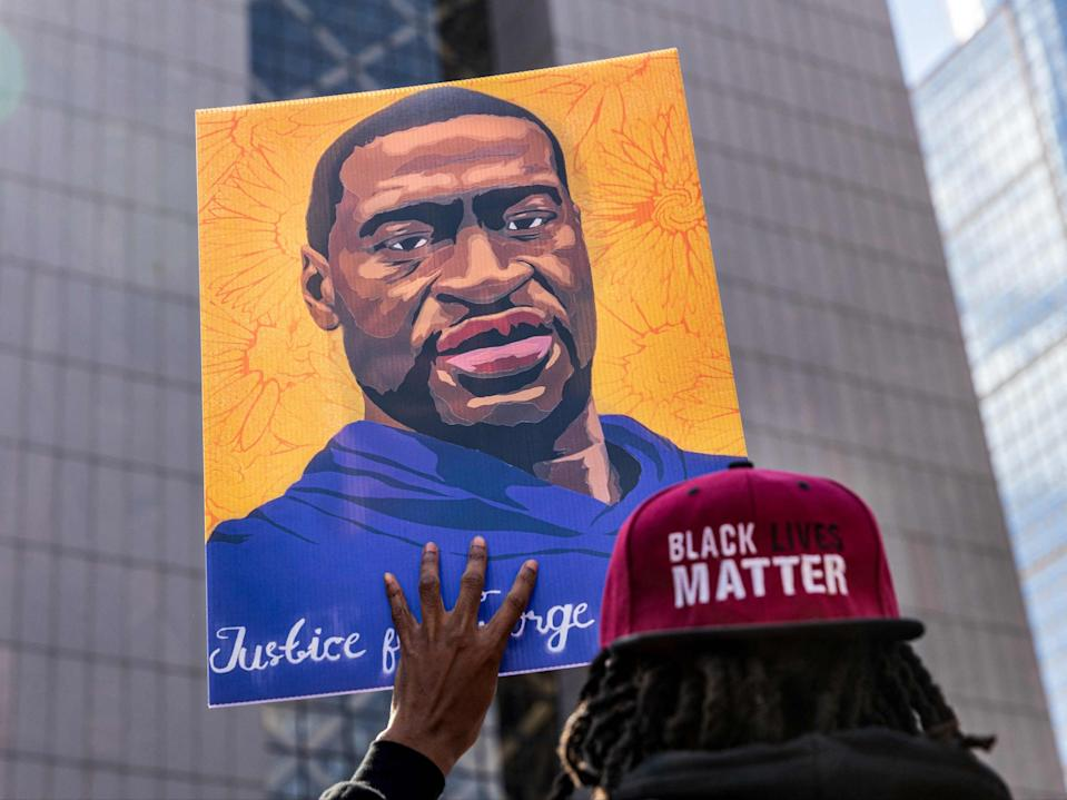 <p>In this file photo demonstrators hold signs honouring George Floyd and other victims of racism as they gather during a protest outside Hennepin County Government Centre on 28 March 2021 in Minneapolis, Minnesota</p> ((AFP via Getty Images))