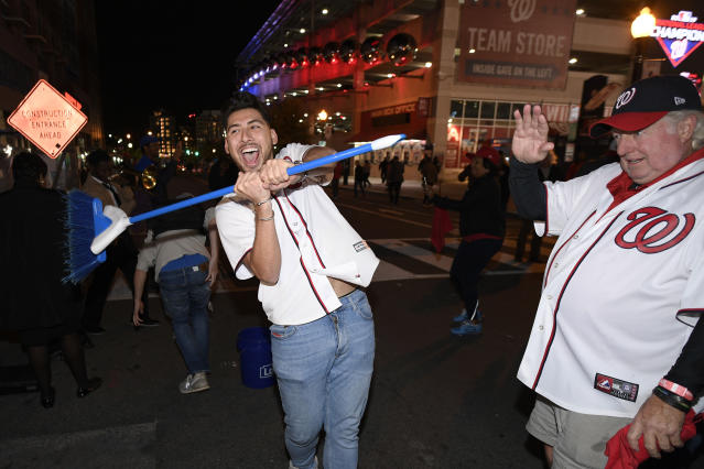 Washington Nationals fans celebrate after the Nationals swept the St. Louis Cardinals in the baseball National League Championship Series, Tuesday, Oct. 15, 2019, in Washington. The Nationals won Tuesday's game 7-4. (AP Photo/Nick Wass)