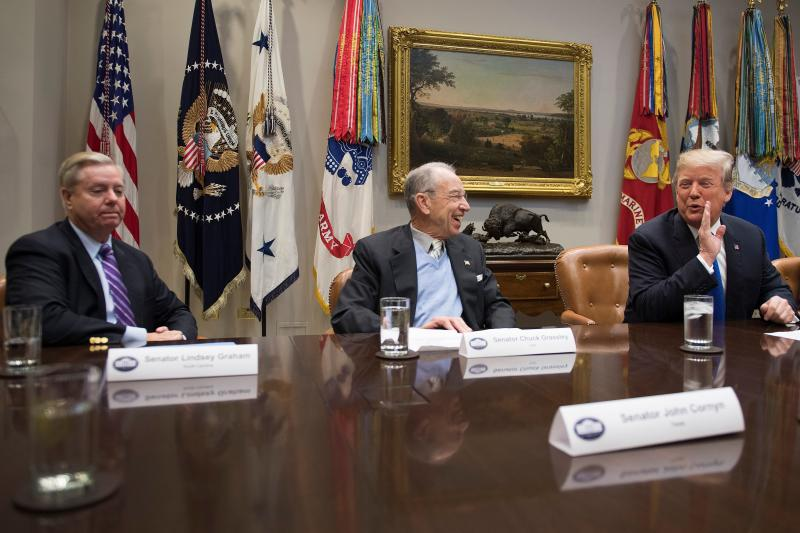 President Donald Trump jokes with Senator Chuck Grassley (R-Iowa) and Sen. Lindsey Graham (R-S.C.) during a meeting at the White House on Jan. 4. (JIM WATSON via Getty Images)