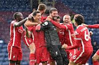 Alisson Becker celebrates scoring Liverpool's winning goal against West Bromwich Albion in stoppage time