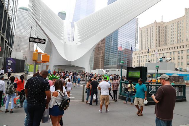 <p>Vendors seek out tourists along Church Street across from the recently opened World Trade Center Transportation Hub in New York City, Aug. 12, 2017. (Photo: Gordon Donovan/Yahoo News) </p>