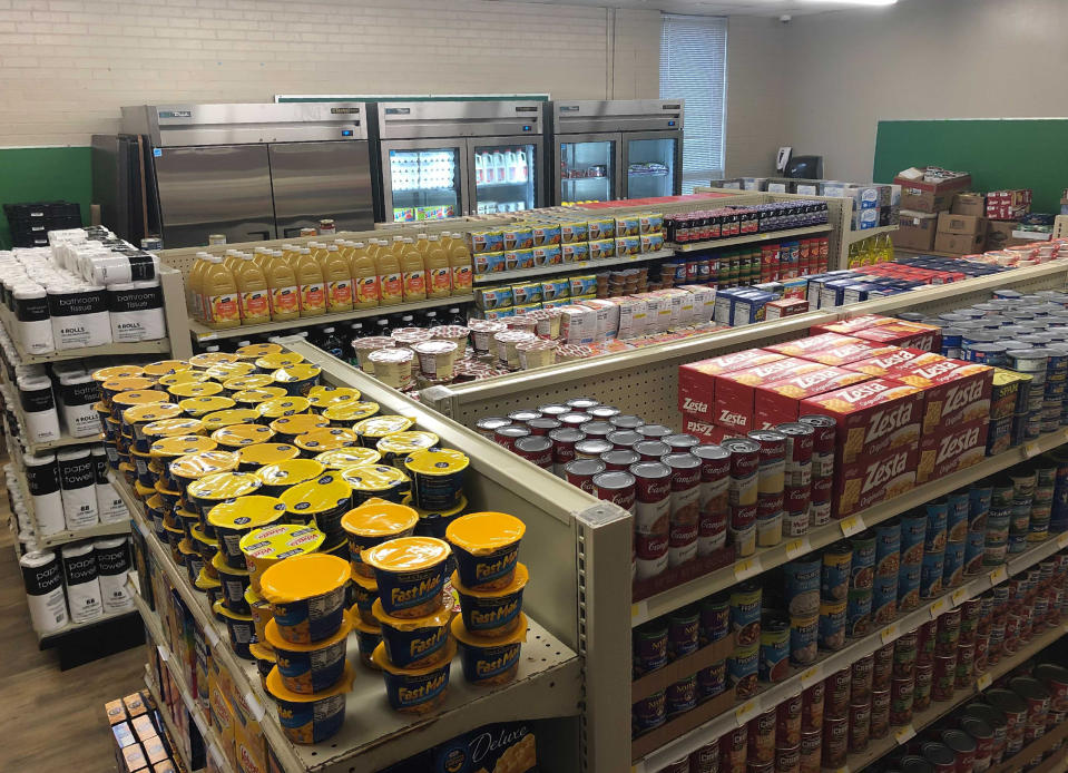 In this photo provided by Anthony Love, food and toiletries line the shelves of Linda Tutt High School's student-led grocery store on Nov. 20, 2020, in Sanger, Texas. (Anthony Love via AP)