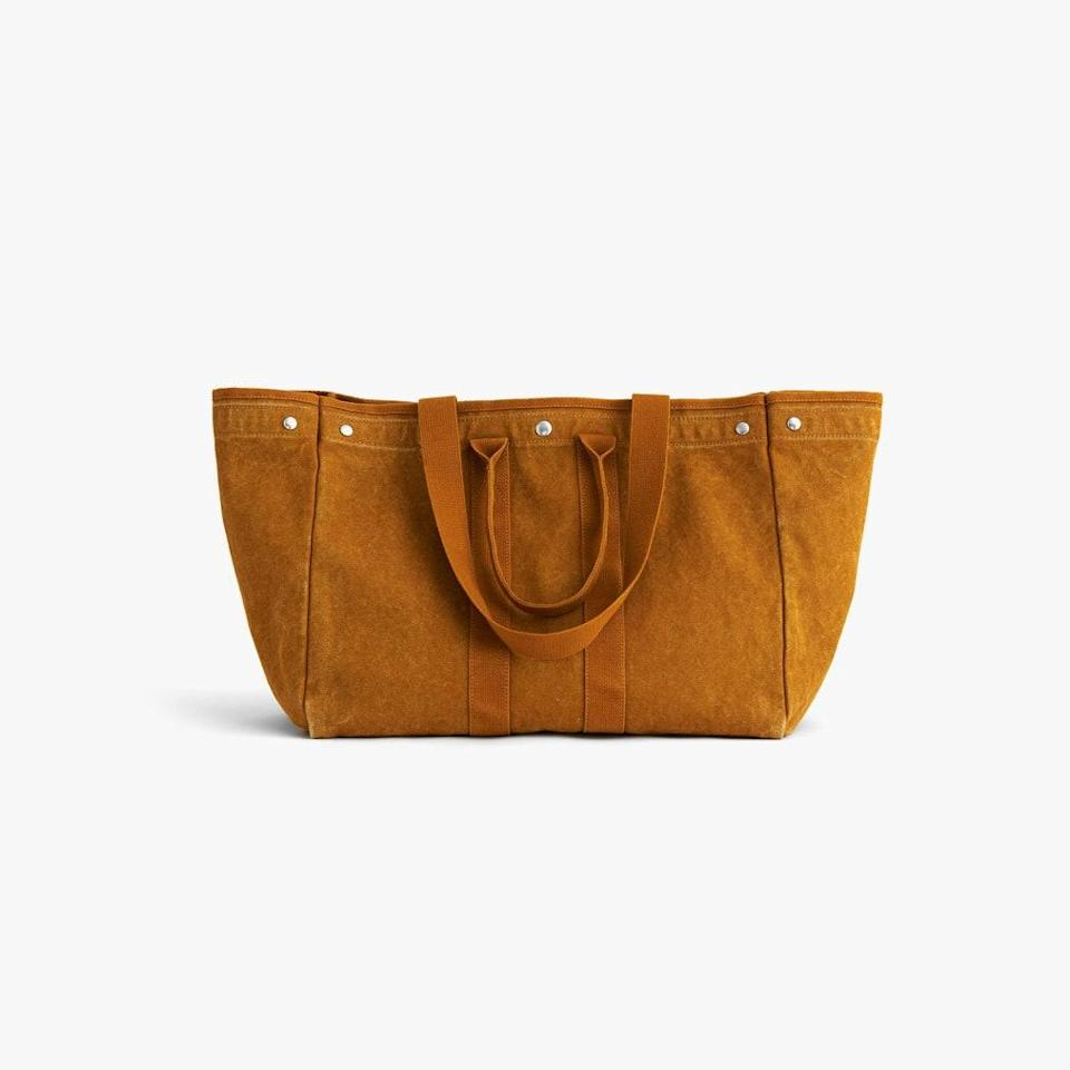"""$165, ALEX MILL. <a href=""""https://www.alexmill.com/collections/mens-accessories/products/double-handle-canvas-tote-in-golden-khaki"""" rel=""""nofollow noopener"""" target=""""_blank"""" data-ylk=""""slk:Buy Now"""" class=""""link rapid-noclick-resp"""">Buy Now</a><br>"""