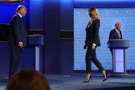 In this Sept. 29, 2020, file photo, President Donald Trump, left, watches as first lady Melania Trump, center, walks on stage past Democratic presidential candidate former Vice President Joe Biden, right, at the conclusion of the first presidential debate at Case Western University and Cleveland Clinic, in Cleveland, Ohio. President Trump and first lady Melania Trump have tested positive for the coronavirus, the president tweeted early Friday. (AP Photo/Julio Cortez, File)
