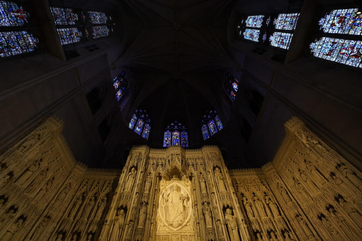 The altar with the Majestus carving of Christ and soaring stained glass windows is seen at the Washington National Cathedral, Thursday, April 1, 2021. (AP Photo/Carolyn Kaster)