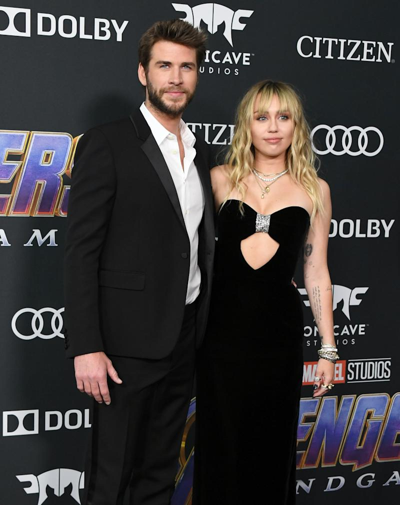 LOS ANGELES, CALIFORNIA - APRIL 22: Liam Hemsworth and Miley Cyrus attend the World Premiere Of Walt Disney Studios Motion Pictures