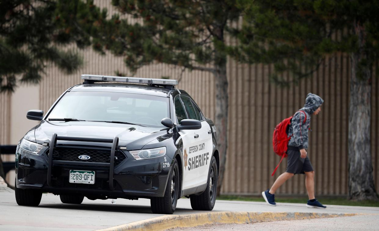 A student leaves Columbine High School in Littleton, Colo., after a lockdown on Tuesday. (AP Photo/David Zalubowski)