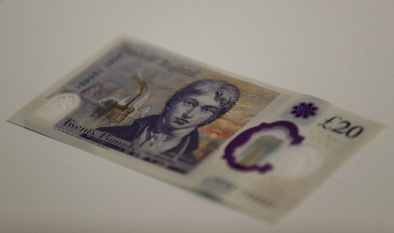 The new 20 pound bank note is displayed during a photo opportunity at the Tate Britain in London, Thursday, Feb. 20, 2020. The new 20 pound note featuring the artist JMW Turner, enters circulation on Feb. 20. (AP Photo/Frank Augstein)