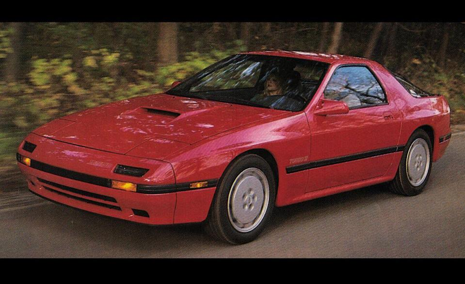 """<p>In a lot of ways, the second-generation Mazda RX-7 was a Porsche 924 for folks who didn't want to spend Porsche money. That wasn't an accident. The team that designed the 1986–1991 RX-7 looked to the 924 and its big brother 944 for inspiration in both styling and dynamics. When Mazda slapped a turbo on the RX-7 for 1987, it turned a knockoff into a knockout and earned a spot on <a href=""""http://www.caranddriver.com/features/1987-10best-cars-feature"""" rel=""""nofollow noopener"""" target=""""_blank"""" data-ylk=""""slk:our 10Best list that year"""" class=""""link rapid-noclick-resp"""">our 10Best list that year</a>.</p>"""