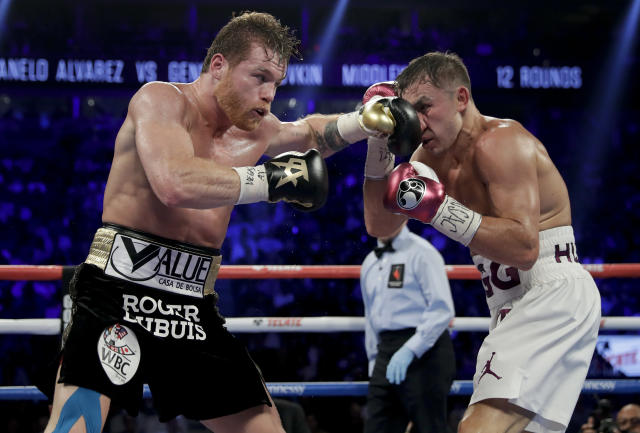 Canelo Alvarez, left, and Gennady Golovkin trade punches in the sixth round during a middleweight title boxing match, Saturday, Sept. 15, 2018, in Las Vegas. (AP Photo/Isaac Brekken)