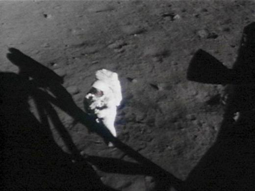 U.S. Astronaut Neil Armstrong turns towards the lunar module on the moon in this handout photo from NASA.