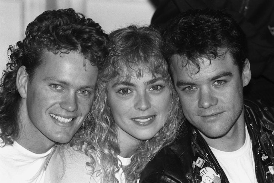 Neighbours star Annie Jones with co--stars Craig McLachlan and Stefan Dennis in the 80s. (PA)