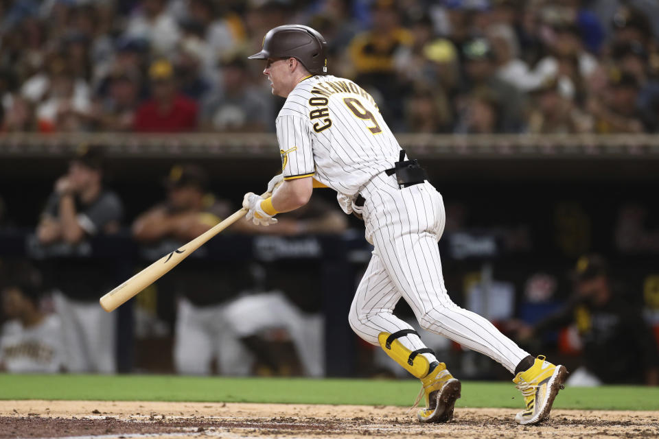 San Diego Padres' Jake Cronenworth watch his RBI single against the Oakland Athletics during the fifth inning of a baseball game Tuesday, July 27, 2021, in San Diego. (AP Photo/Derrick Tuskan)