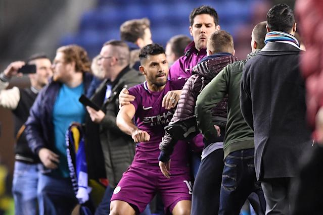 "Sergio Aguero was surrounded by Wigan fans as he attempted to leave the pitch after <a class=""link rapid-noclick-resp"" href=""/soccer/teams/manchester-city/"" data-ylk=""slk:Manchester City"">Manchester City</a> FA Cup loss. (Getty)"