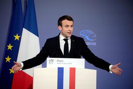 FILE PHOTO: French President Emmanuel Macron delivers a speech during the closing session of the Intelligence College in Europe meeting at the Foreign Affairs Ministry in Paris