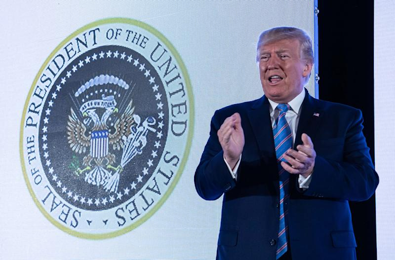 President Donald Trump stands next to a surreptitiously altered presidential seal as he arrives to address the Turning Point USAs Teen Student Action Summit 2019 in Washington, DC, on July 23, 2019. (Photo: Nicholas Kamm/AFP/Getty Images)