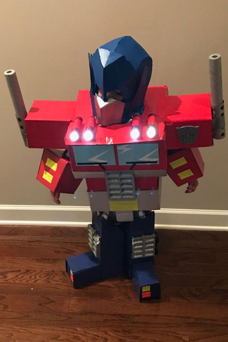 "<p>A little boy disguised as a robot disguised as a truck ... with working lights became the ultimate Transformer. </p><p><strong>RELATED: </strong><a href=""https://www.goodhousekeeping.com/holidays/halloween-ideas/g385/popular-kids-halloween-costumes/"" rel=""nofollow noopener"" target=""_blank"" data-ylk=""slk:65 Kids' Halloween Costume Ideas for Easy, Creative, and Unique Trick-or-Treating"" class=""link rapid-noclick-resp"">65 Kids' Halloween Costume Ideas for Easy, Creative, and Unique Trick-or-Treating</a></p>"