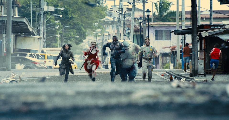 "Ratcatcher 2 (Daniela Melchior, far left), Harley Quinn (Margot Robbie), Bloodsport (Idris Elba), King Shark (voiced by Sylvester Stallone) and Polka-Dot Man (David Dastmalchian) run into some trouble in ""The Suicide Squad."""