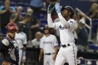 Miami Marlins' Jazz Chisholm Jr. gestures to the crowd after hitting his second solo home run of the game during the fifth inning of a baseball game against the Washington Nationals, Monday, Sept. 20, 2021, in Miami. (AP Photo/Marta Lavandier)