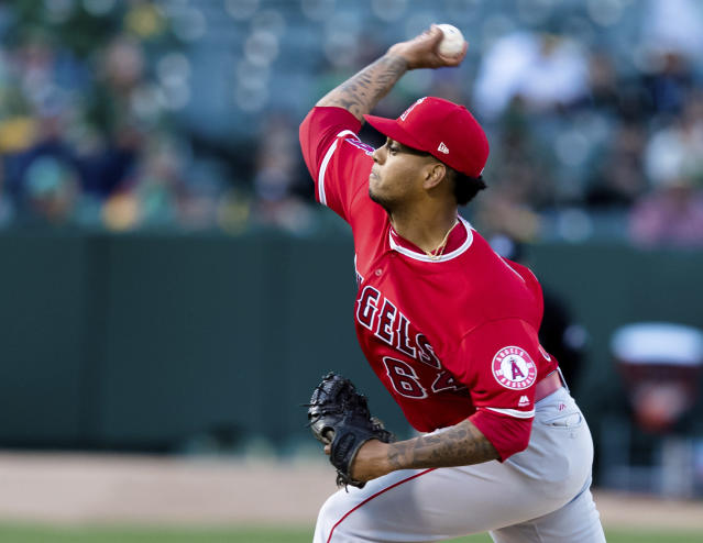 Los Angeles Angels starting pitcher Felix Pena throws against an Oakland Athletics batter in the first inning of a baseball game, Saturday, March 30, 2019 in Oakland, Calif. (AP Photo/John Hefti)
