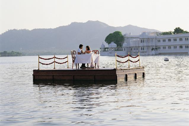 """Taj Lake Palace, Udaipur - This locale has been used in a James Bond movie and can be stunningly romantic, with chefs cooking gourmet dinners on pontoons near the boat as you sail around Lake Pichola. The hotel will also set off fireworks the moment she says """"Yes"""". You could also head for the Kerela backwaters. Spend a day drifting on The Park Hotels' MV Apsara on Vembanad Lake or rent a rice boat, and splurge the day on the isolated canals and passages of the backwaters sipping cold beer."""