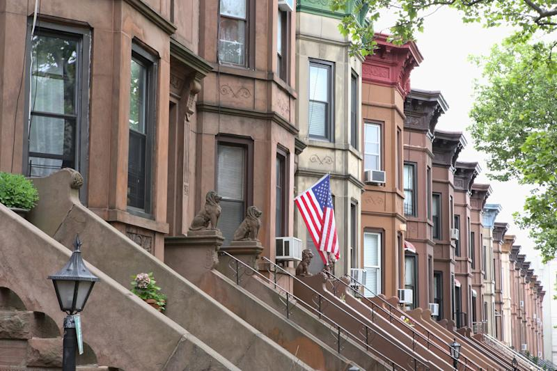American flag hanging from the front door of a brownstone in a typical middle-class residential neighborhood in Brooklyn, New York City.