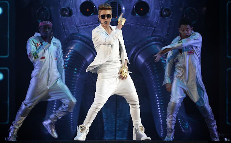 "FILE - This March 28, 2013 file photo shows Canadian singer Justin Bieber performing during the ""I Believe Tour "" in Munich, southern Germany. Billboard announced Wednesday, April 3, that Bieber, Taylor Swift, Bruno Mars and R&B singer Miguel will perform at the Billboard Music Awards on May 19 in Las Vegas(AP Photo/Matthias Schrader,File)"