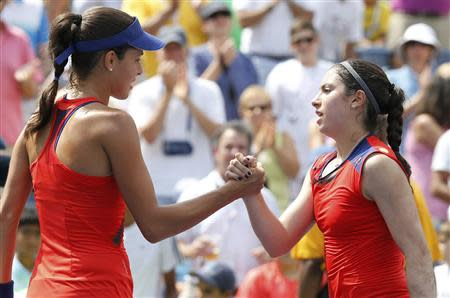 Ana Ivanovic (L) of Serbia is congratulated by Christina McHale of the U.S. after her victory at the U.S. Open tennis championships in New York August 31, 2013. REUTERS/Ray Stubblebine